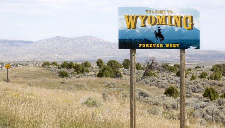 A welcome to Wyoming sign at the state border.