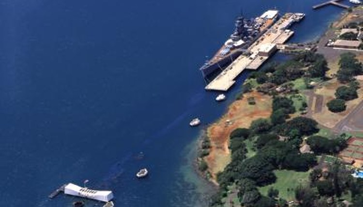 Aerial view of the Arizona Memorial and USS Missouri battleship near Ford Island in Pearl Harbor, Oahu, HI