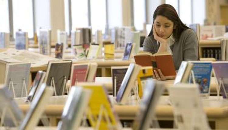 High school student reading in school library