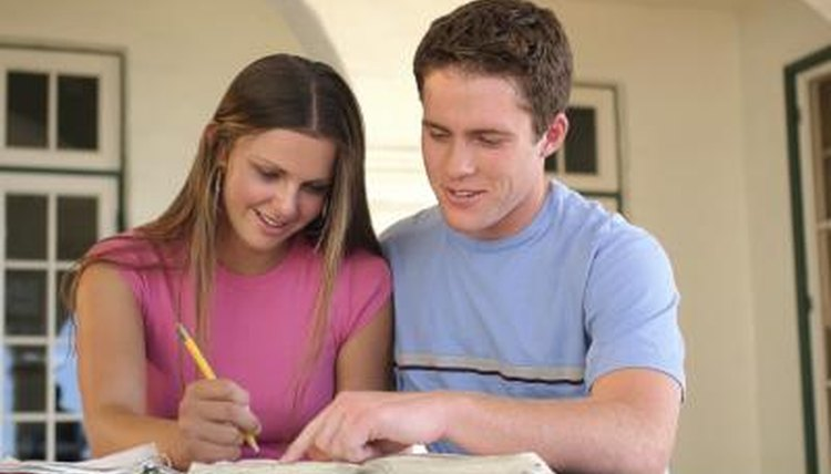 Teenagers working together on homework.