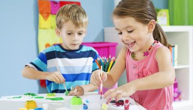 children painting in preschool