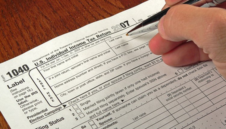 Filling out tax form 1040.