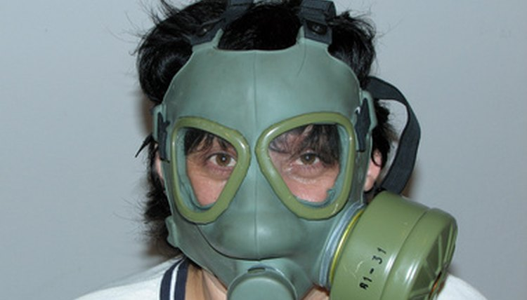 A gas mask provides oxygen to the user by filtering the surrounding air around him.