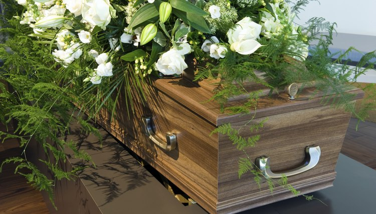 A bouquet of flowers on a coffin.
