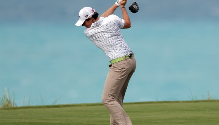 Rory McIlroy's back faces his target at the top of his swing after a full shoulder turn.