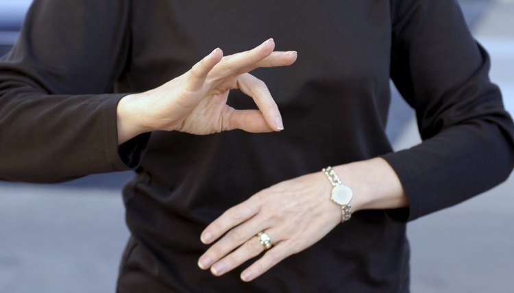 Sign language helps deaf people communicate face to face.
