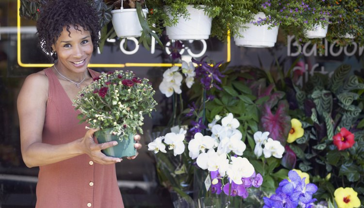 A woman is in her flower shop.