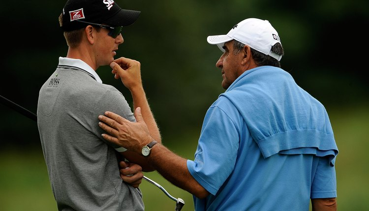 Tour player Henrik Stenson confers with sports psychologist Bob Rotella. Pros understand the importance of the mental game.
