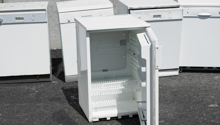 Mini-fridge and other appliances set outside