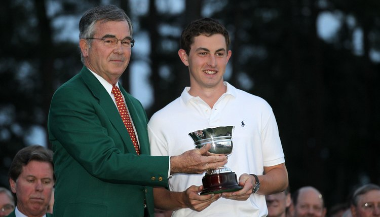 Patrick Cantlay (right) receives an award as the low amateur player at the 2012 Masters. The trophy did not violate Cantlay's amateur status.