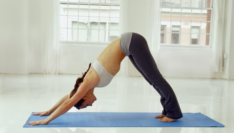 """Downward Facing Dog"" is one yoga pose that stretches back muscles."
