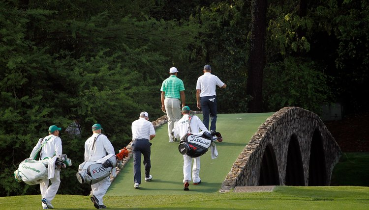 A caddie's main job is to carry his player's clubs.