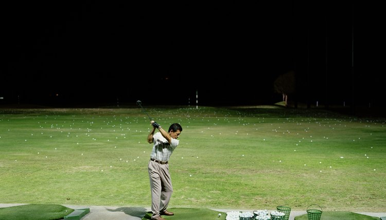 Improve your golf game with regular sessions at the driving range.
