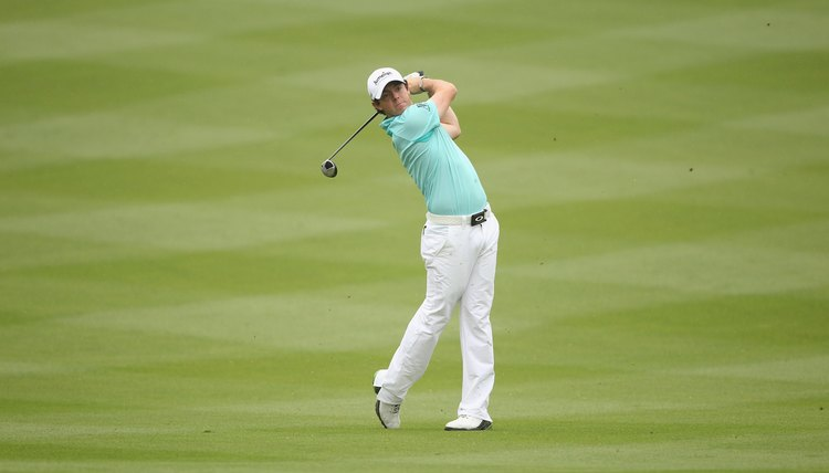 McIlroy's hips have turned completely and his weight is on his left side.