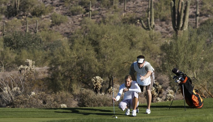 Helping a golfer read a green may be a part of a caddie's role.