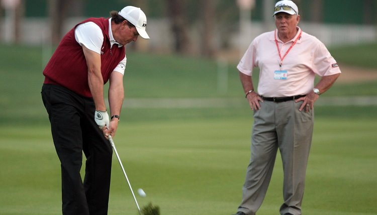 Long time pro instructor Butch Harmon helps Phil to hit the fairways in regulation.