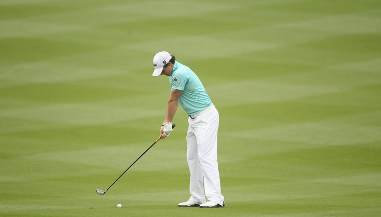 McIlroy begins his takeaway with his shoulders, not by lifting the club with his wrists.