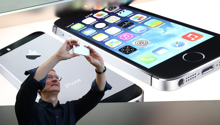 Apple's CEO Tim Cook uses his iPhone to snap a quick picture.