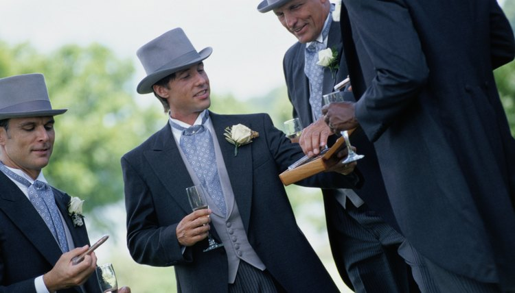 Groomsmen work together to ensure the wedding ceremony and reception proceed as planned.