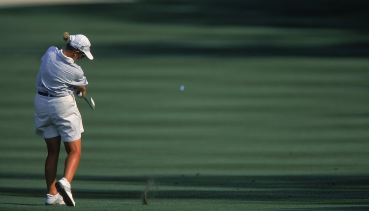 To make the ball slice to the right, Karrie Webb swings so far to the left that you can't even see her hands