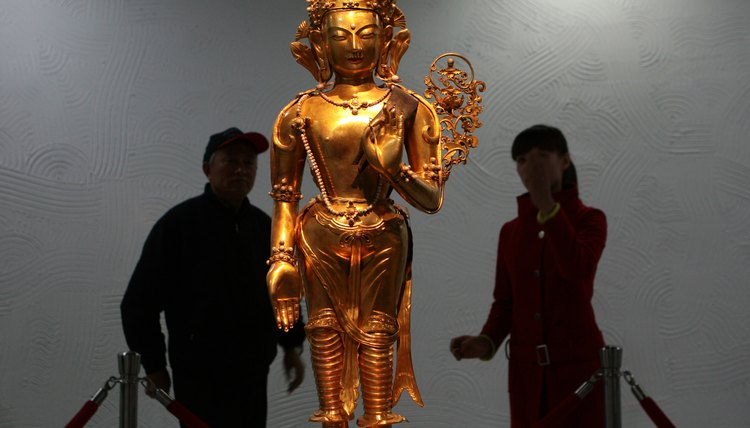 Statues of Guan Yin, the bodhisattva of compassion, are revered in Buddhist cultures.