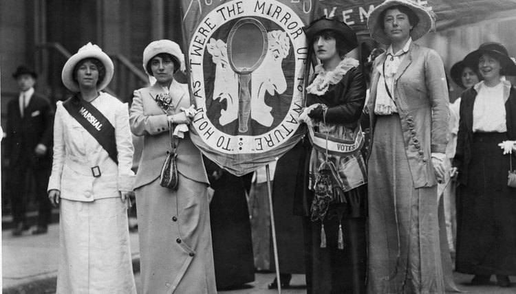 Suffragists participating in a parade for women's rights.