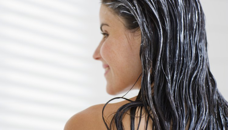 Thoroughly apply the deep conditioner throughout your hair.