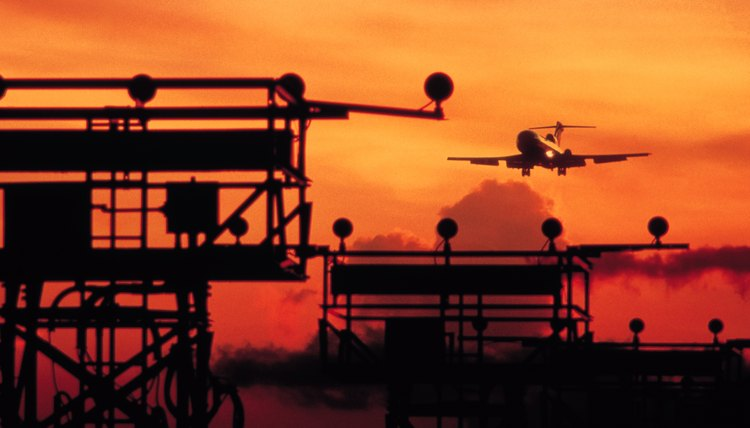 Air traffic controllers regulate the flow of air traffic.