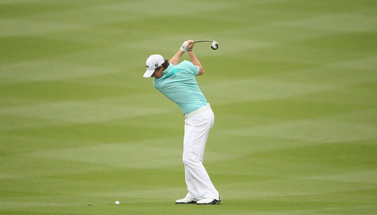 With his right elbow bent and slightly away from his side, McIlroy's wrists finish setting at the top of his backswing.