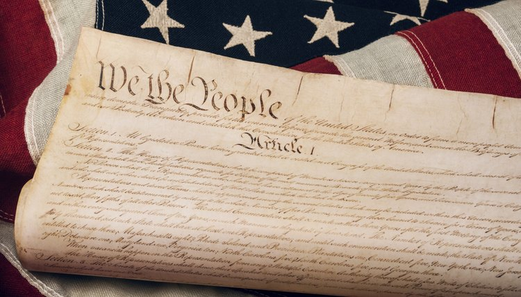 A replica of the U.S. Constitution atop an American flag