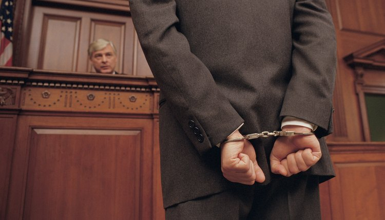 Man in handcuffs faces judge in court