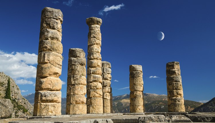 A crescent moon in the sky above an ancient Greek temple.