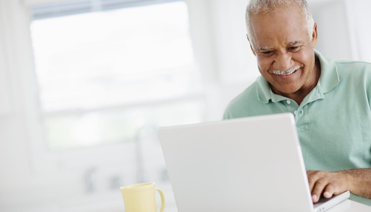 40 year old man looking at bank accounts online