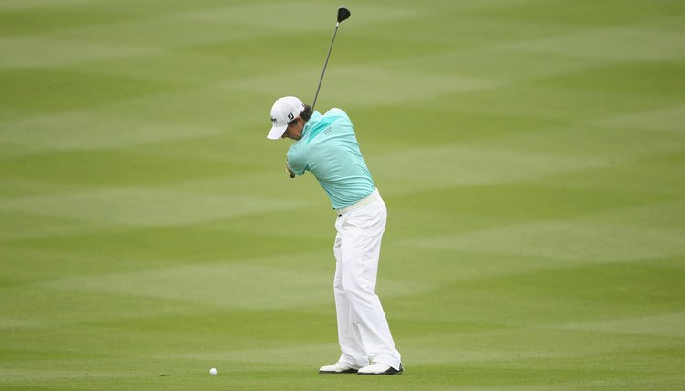 With his left arm parallel to the ground, McIlroy's shoulder turn is nearly complete and his wrists have cocked.