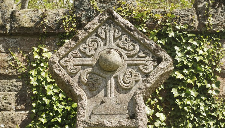 A Rosicrucian cross stone carving in a cemetery in Roslin, Scotland.