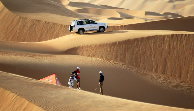 All pro golfers travel a lot, but only the best, such as Martin Kaymer, ever do a photoshoot in a sand trap this big.