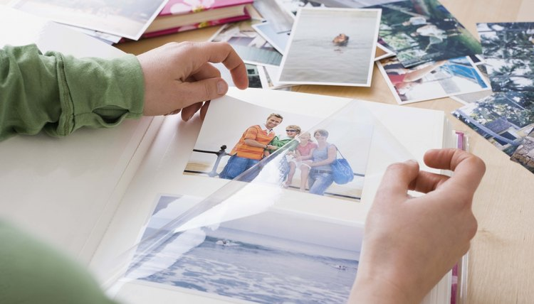 Compiling a photo album is one way to celebrate the memory of a loved one.