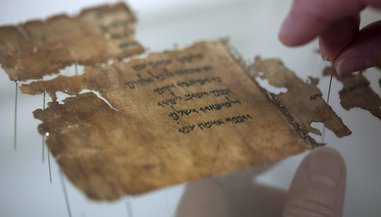Preparation of a fragment of the Dead Sea Scrolls for study.
