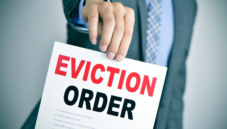 man in suit with an eviction order