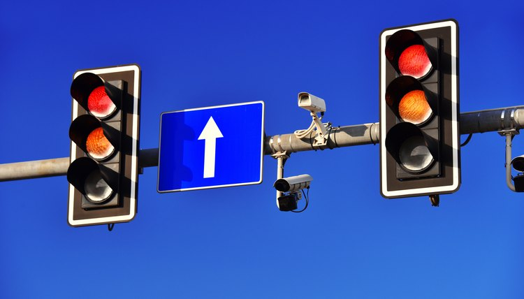 Traffic lights and camera over blue sky