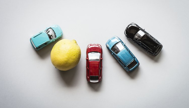 Overhead view of toys cars and a lemon