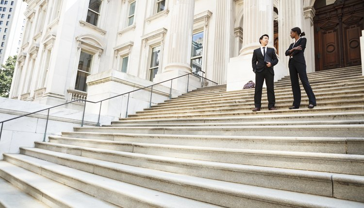 Lawyer and client on the steps of a court house