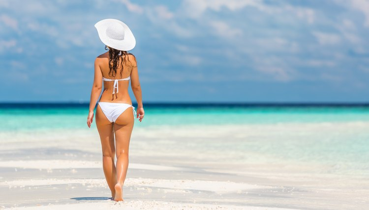 Woman in a bikini walking on the beach