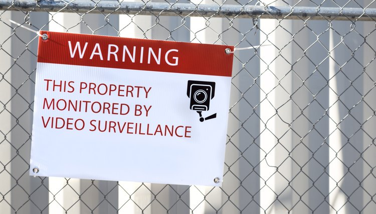 Video Surveillance Warning Sign on Fence
