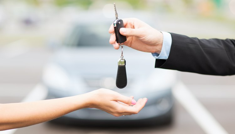 Man handing over the keys to a car