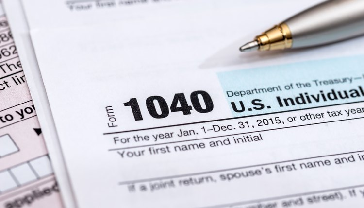 1040 us tax form with pen