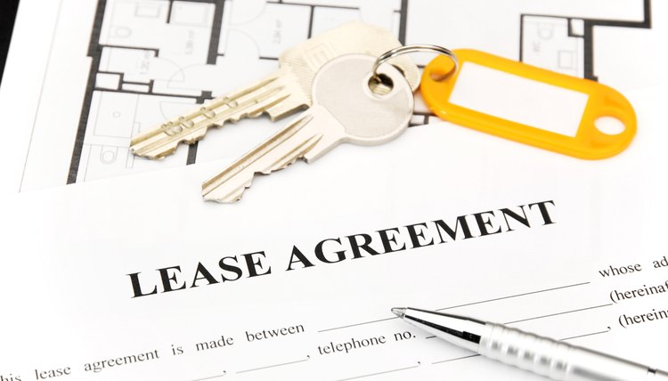 Keys and pen on lease agreement document
