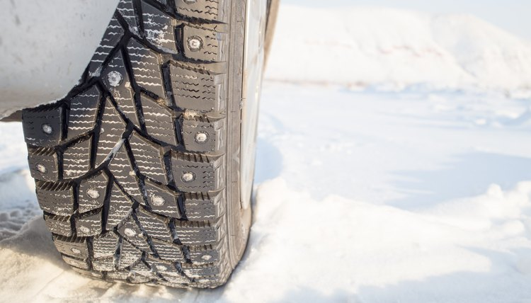 Winter studded tire in snow