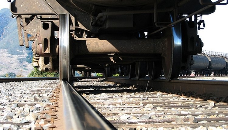 Railroad tracks and train wheels are made of steel.