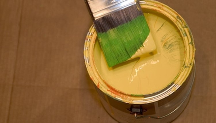 A can of latex paint and brush.